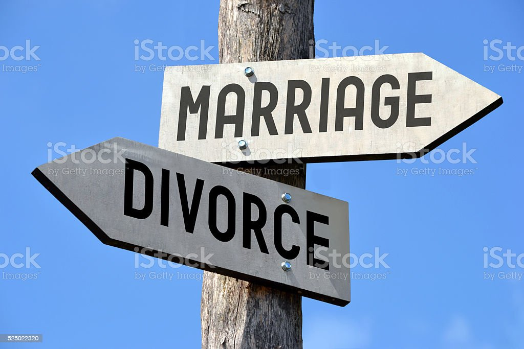 Marriage and divorce signpost stock photo