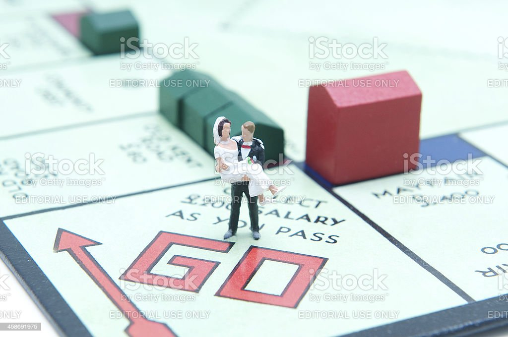 Marriage and Finance London, UK - July 2, 2011: Married couple at the starting point of the board game monopoly Aspirations Stock Photo