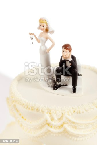 istock Marriage Ball and Chain Humorous Wedding Cake Topper on White 186610262