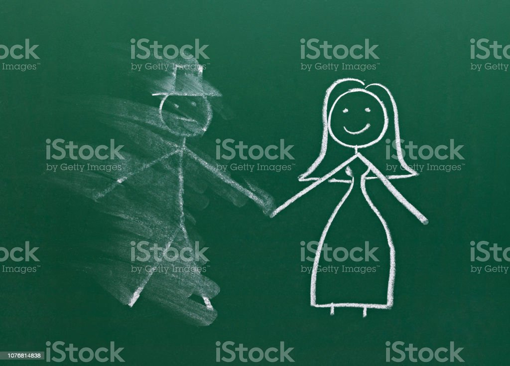 marriage couple drawing on chalk board divorce break up smudged stock photo