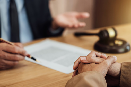 istock Marriage divorce on Judge gavel deciding, Consultation between a Businesswoman and Male lawyer or judge consult having yes or no to signing divorce documents, Law and Legal services concept 1029713984