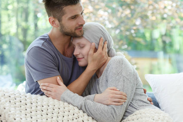 Marriage fighting with cancer together stock photo
