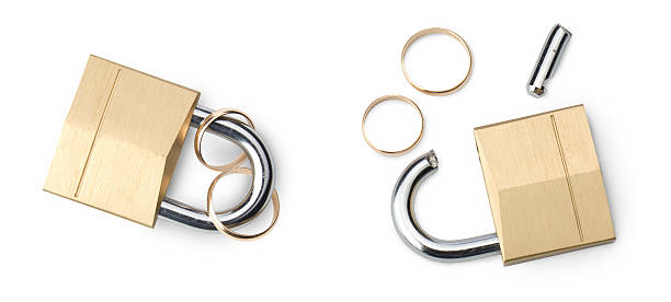 Marriage happy or divorced: Padlocks closed and broken stock photo