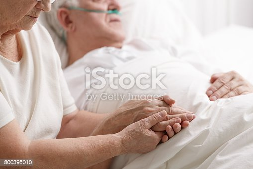 Senior caring loving marriage holding hand's in hospital