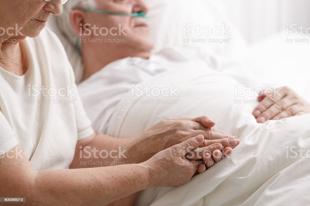 Marriage holding hand's in hospital stock photo