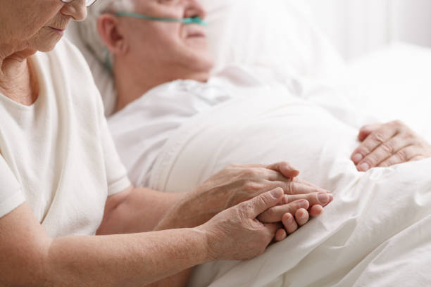 marriage holding hand's in hospital - death stock pictures, royalty-free photos & images