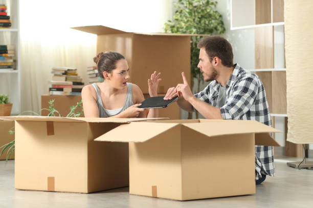 marriage moving home fighting for a tablet - oggetti personali foto e immagini stock