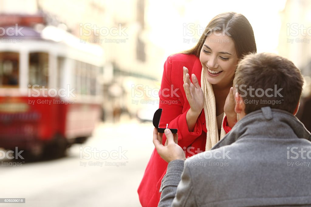 Marriage proposal in the street stock photo