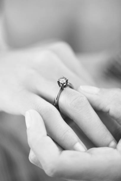 marriage proposal with diamond ring - diamond ring hand stock photos and pictures