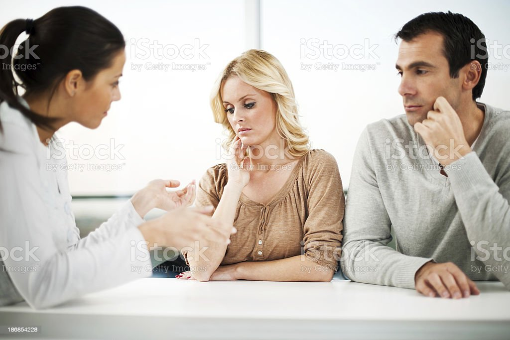 Marriage therapy. Couple with a psychiatrist. royalty-free stock photo