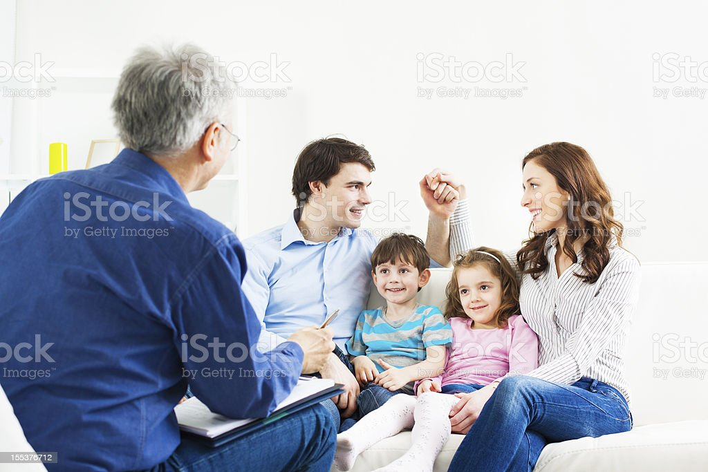 Marriage Therapy. Family Talking to Counselor stock photo