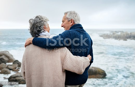 Rearview shot of a senior couple enjoying some quality time together at the beach