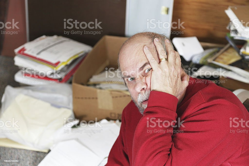 Married ADD Man Upset With Messy Papers and Boxes royalty-free stock photo