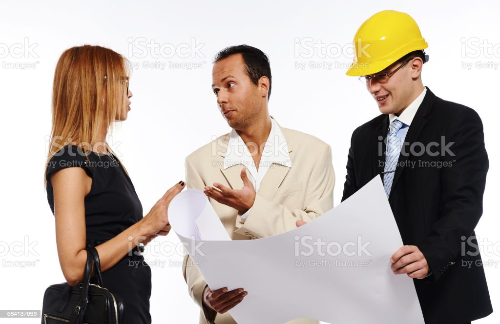 Married couple and architect looking to the blueprint zbiór zdjęć royalty-free
