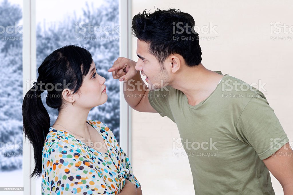 Married couple arguing at home stock photo