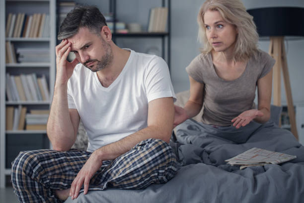 Married couple arguing in bedroom Middle-aged married couple having problems and arguing about their relationship in bedroom erectile dysfunction stock pictures, royalty-free photos & images