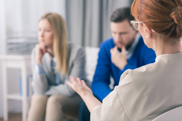 Married couple during a therapy session with a psychologist stock photo