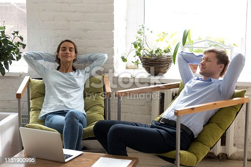 938682762istockphoto Married couple freelancer or colleague take a break resting 1131900995
