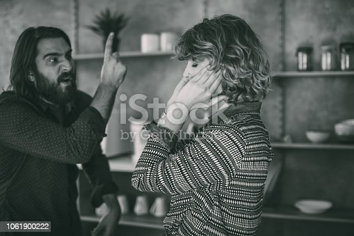 Man and woman, married couple arguing at home, black and white.