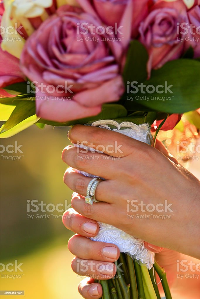 Married Couple Holding Hands at Wedding stock photo