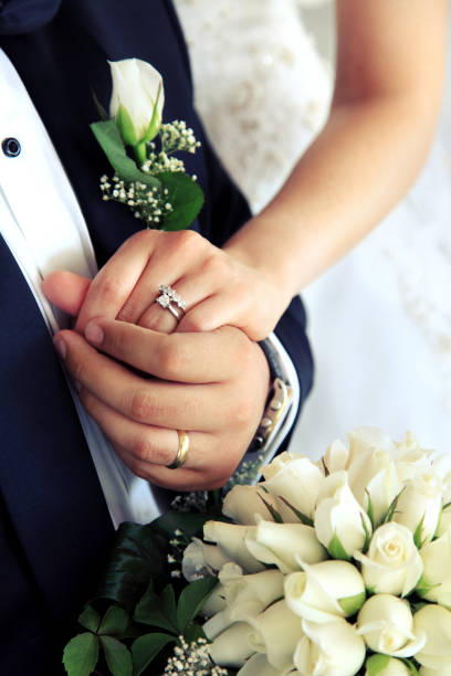 married couple holding hands - diamond ring hand stock pictures, royalty-free photos & images