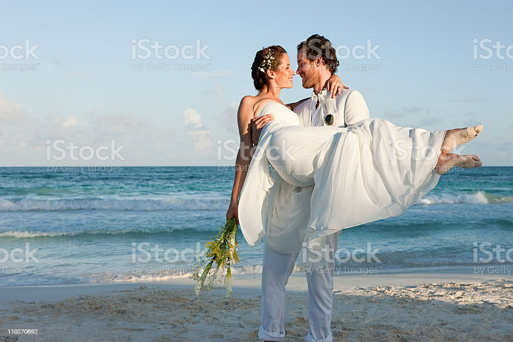 Married couple on beach stock photo