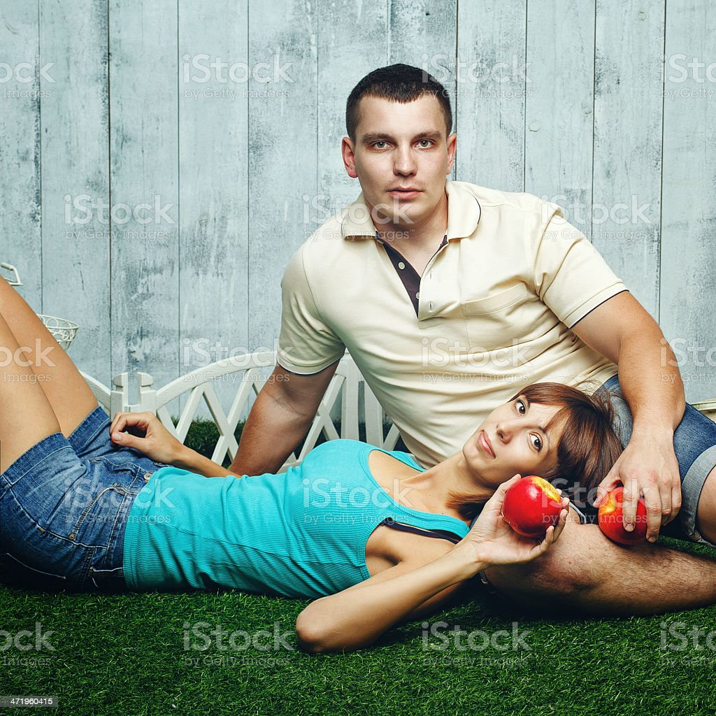 Married couple on the lawn stock photo