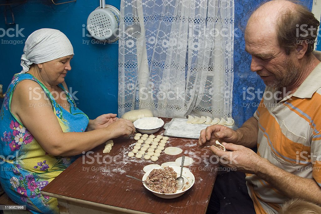 Married couple prepares dumplings. royalty-free stock photo