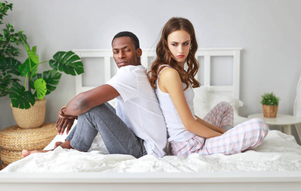 married couple quarreled offended by  problems in bed married couple quarreled offended by stress and problems in bed background of the sad couple fighting bed stock pictures, royalty-free photos & images