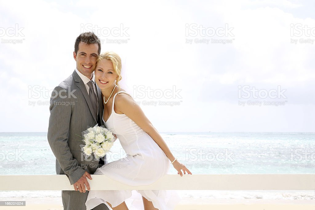 Married couple sitting on a fence royalty-free stock photo
