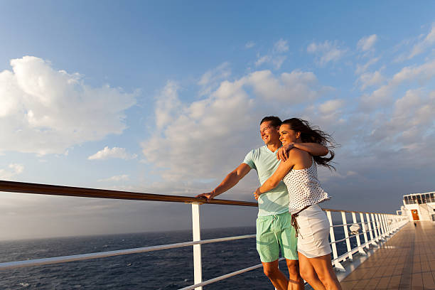 married couple standing on cruise deck - cruise ship stock photos and pictures