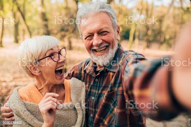 Married couple taking a selfie picture id1070115302?b=1&k=6&m=1070115302&s=612x612&h= auwklch6ks3n nhtk9ddi1lva5tu5qwwbctdpo2qju=