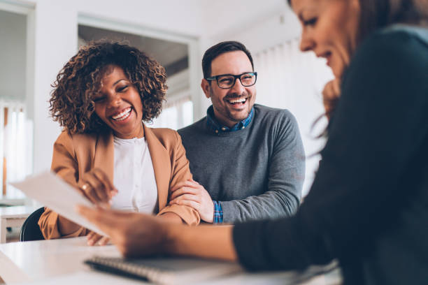 Married couple talking with financial advisor on a meeting stock photo