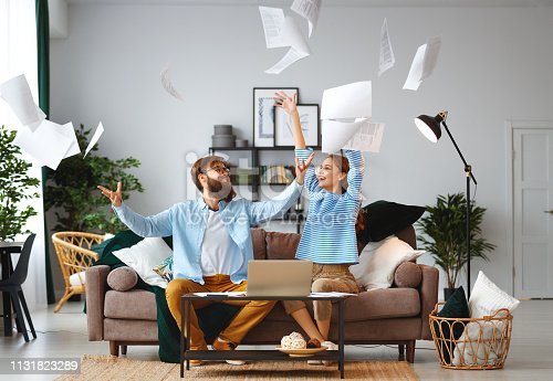 istock married couple with bills receipts documents and laptop at home 1131823289