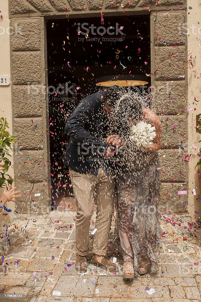 Married couple with bouquet of flowers and rice royalty-free stock photo