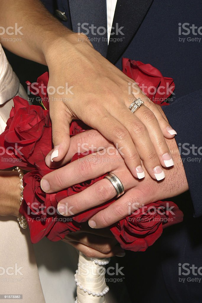Married Hands on Red Flowers royalty-free stock photo