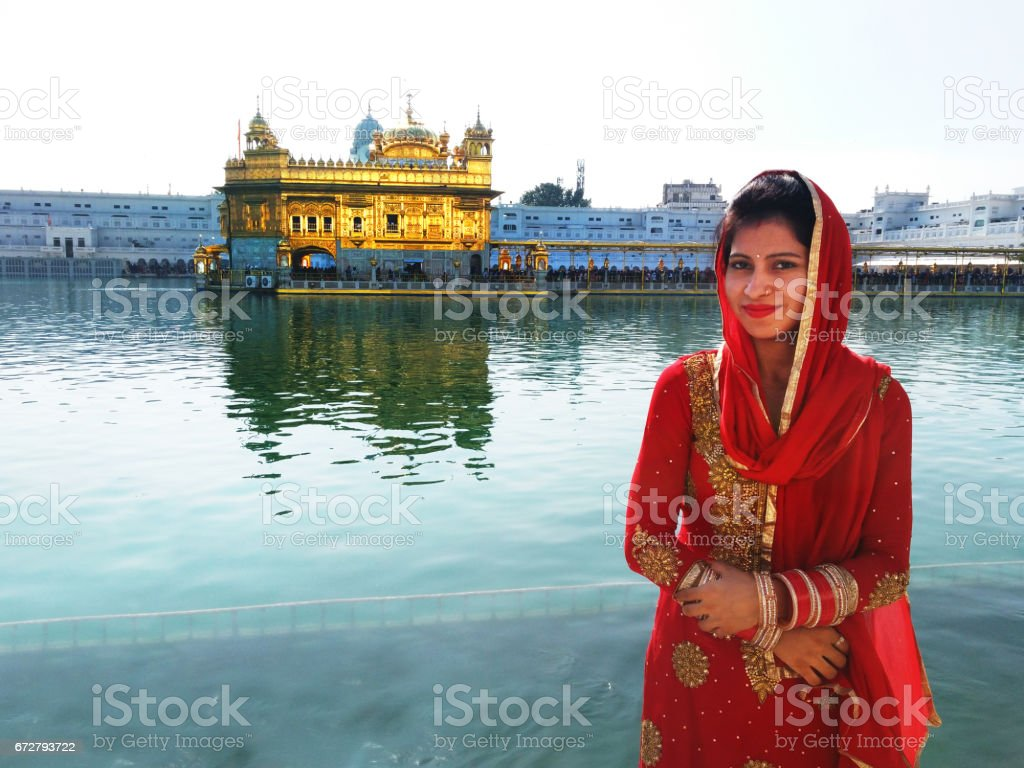 Married women near the golden temple stock photo