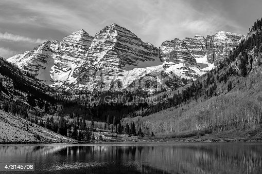 The spectacular beauty of the Maroon Peaks in black and white with dramatic sky, near Aspen, CO.