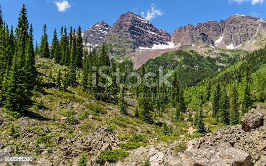 A close-up spring view of rugged Maroon Bells, seen from Crater Lake Trail, Aspen, Colorado, USA.