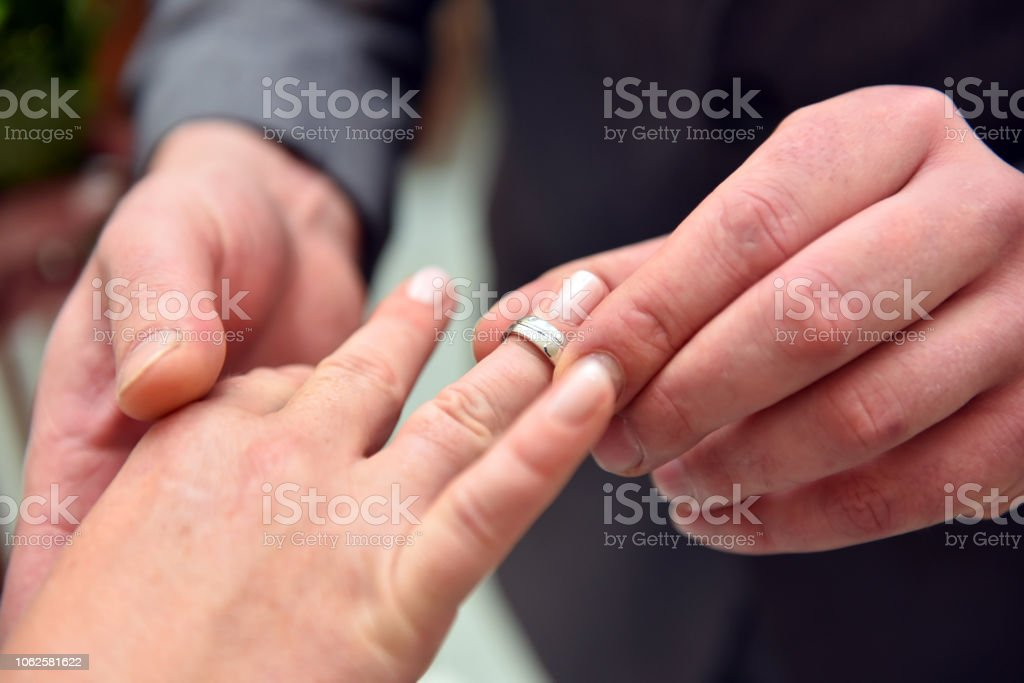Marry, yes say, ring infect stock photo