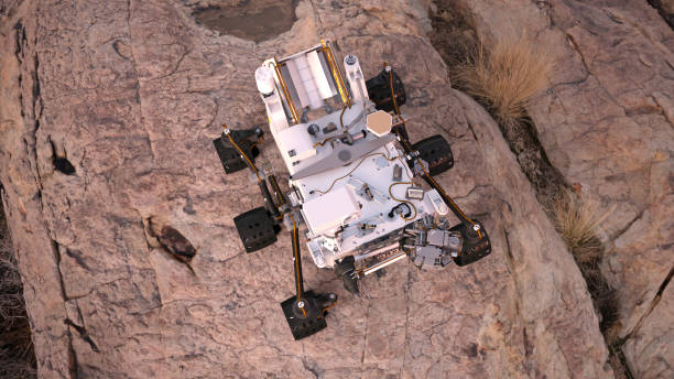 Mars Rover, robotic space autonomous vehicle on a deserted planet, top view, 3D illustration Mars Rover, robotic space autonomous vehicle on a deserted planet, view from the top, 3D illustration rover stock pictures, royalty-free photos & images