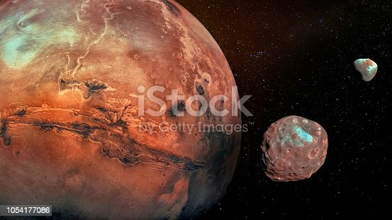 istock Mars with its two cratered moons Phobos and Deimos. Elements of this image furnished by NASA. 1054177086