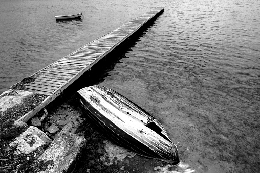 wooden jetty with boats on the Stagnone lagoon Marsala Trapani Sicily Italy