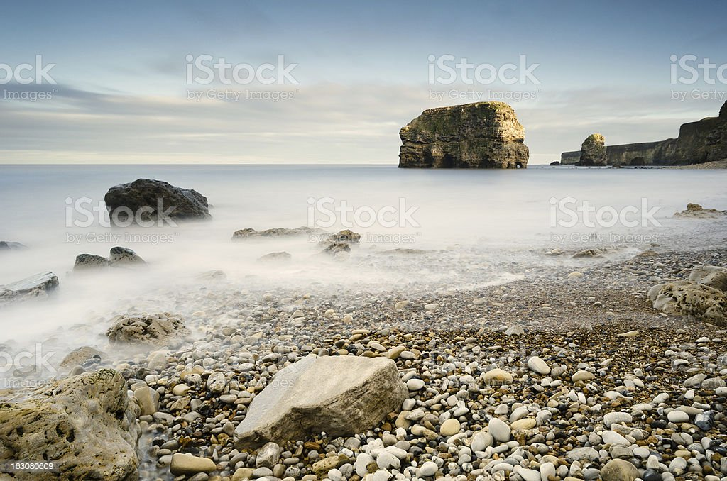 Marsden Rock in smooth water royalty-free stock photo