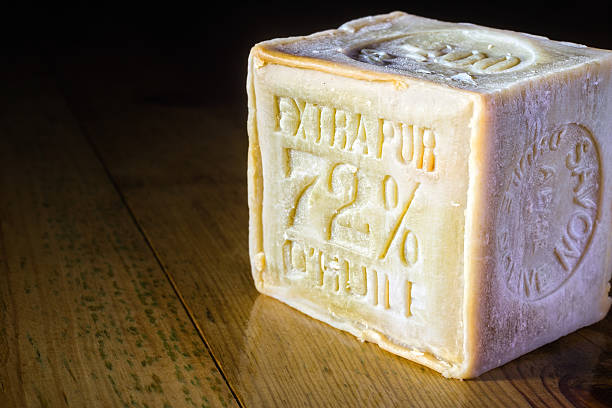 Marseille Soap bar with 72% olive oil on wooden table stock photo