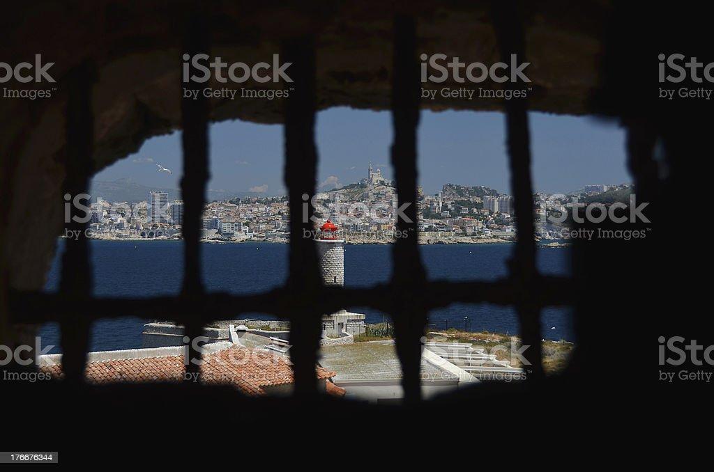 Marseille through iron-barred window royalty-free stock photo