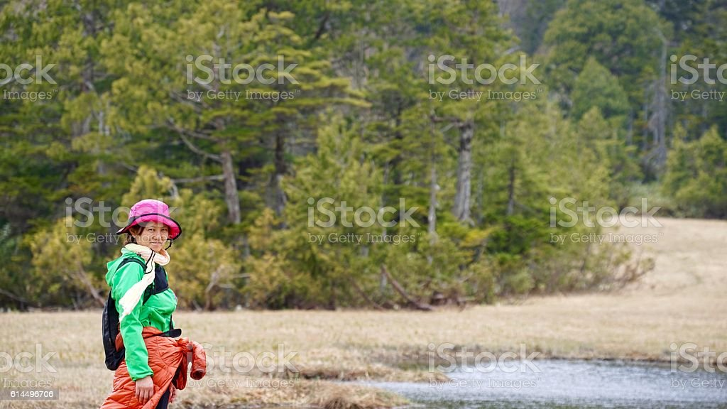 Marsh in wetlands and girl at early spring - foto de stock