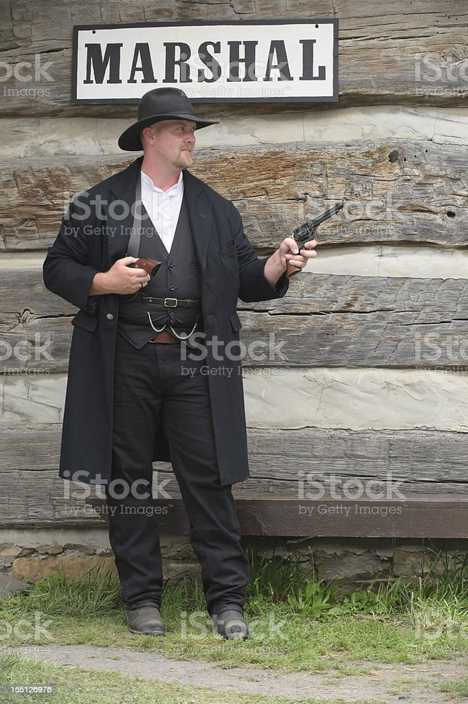 Marshal of the Old American West with Pistols Drawn stock photo