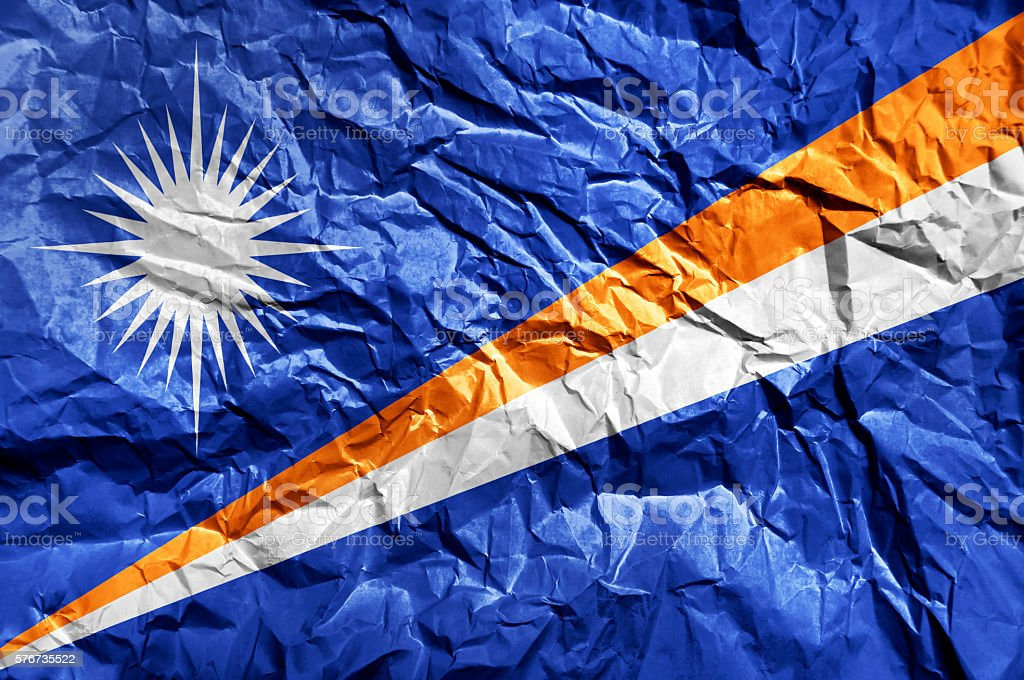 Marshall Islands flag painted on crumpled paper background stock photo