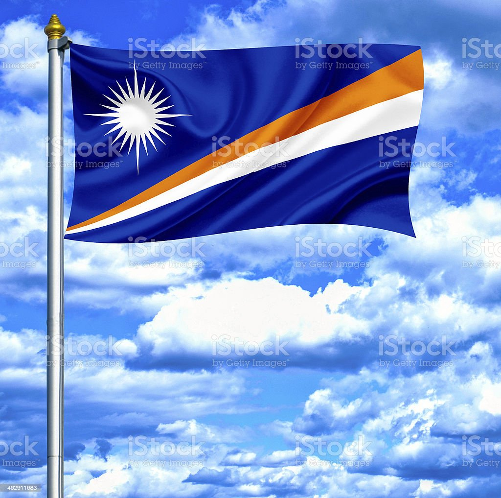 Marshall islands waving flag against blue sky stock photo
